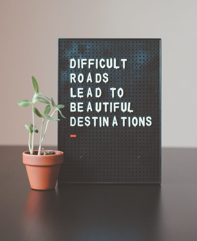 """Magnetic sign with the words """"Difficult roads lead to beautiful destinations"""""""